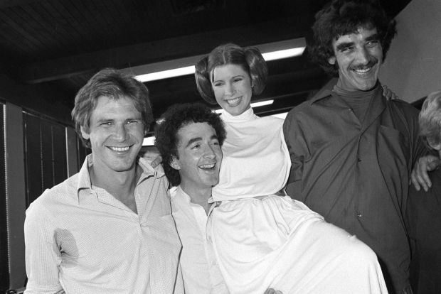 From left to right: actors Harrison Ford, Anthony Daniels, Carrie Fisher and Peter Mayhew take a break from filming a television special in Los Angeles in 1978. Photograph: George Brich/AP/File