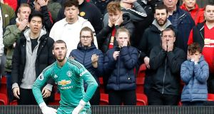 Manchester United goalkeeper David de Gea sits dejected after Chelsea's Marcos Alonso scored the equaliser during the Premier League clash at Old Trafford. Photo: Martin Rickett/PA Wire