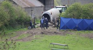 Garda forensics and a diver at work near a slurry tank Bobby Ryan's body  was discovered at the back of farm in Fawnagown outside Tipperary town. Photograph: Press 22