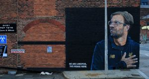 A painted mural of Liverpool manager Jurgen Klopp on Jordan Street in the city's Baltic Triangle. Photograph: Getty Images