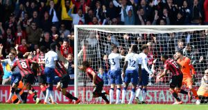 Bournemouth celebrate Nathan Ake's last minute winner against Spurs. Photograp: Dylan Martinez/Reuters