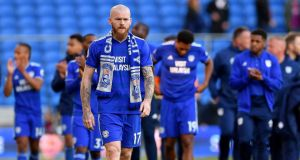 Aron Gunnarsson thanks to home fans at Cardiff City Stadium after his team's defeat to Crystal Palace. Photograph: PA