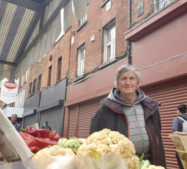 Angela Wright, whose vegetable stall is directly under the national monument (plaque pictured top right of picture). Photograph: Ronan McGreevy