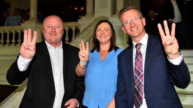 Frank McCoubrey, Nicola Verner and Brian Kingston of the DUP celebrating success at Belfast City Hall. Photograph: Mark Marlow/PA Wire