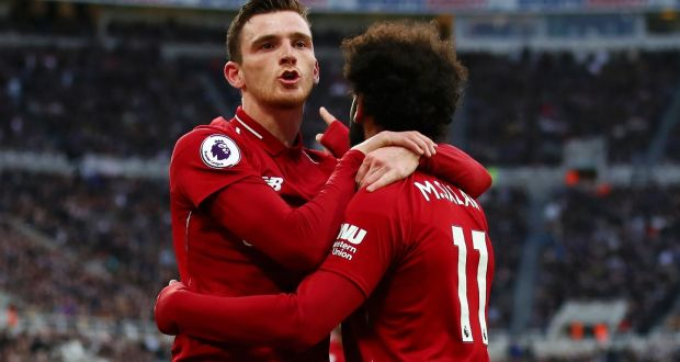 7faf0d2fb4f Mohamed Salah of Liverpool celebrates with teammate Andy Robertson at St  James' Park. Photograph