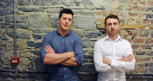 Barry O'Mahony and Tiernan Kennedy of Umba: the fintech start-up  already has 170,000 customers in Africa, many of whom lack access to basic banking facilities, but can use Umba's smartphone app. Photograph: Aidan Crawley/The Irish Times