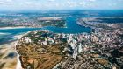 Dar es Salaam in Tanzania. The East African country is  more than 10 times the size of the Republic, and has  an estimated population of about 60m