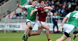 London's Michael Clarke puts pressure on Galway's Michael Daly during their Connacht Championship clash in Ruislip. Photograph: Gerry McManus/Inpho