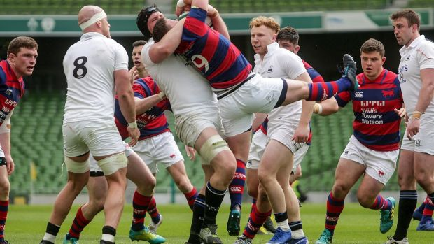 Clontarf's Andrew Feeney is tackled by Evan Mintern of Cork Constitution in the final of the All-Ireland League Division 1A at the Aviva stadium. Photograph: Laszlo Geczo/Inpho