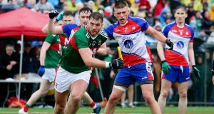 Mayo's Aidan O'Shea and Matthew Queenan of New York in action. Photograph: Andy Marlin/Inpho