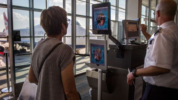 A woman boarding a SAS flight goes through facial recognition verification system, at Dulles airport in Virginia. Photograph: Jim Watson/AFP/Getty Images