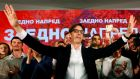 Presidential candidate Stevo Pendarovski celebrates after preliminary results during the presidential election in Skopje. Photograph: Ognen Teofilovski/Reuters