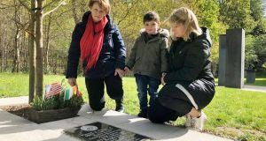 Ann Flynn with her daughter Norma Flynn and grandson Tadhg Gleeson at the memorial in Donadea Forest Park to her Kildare-born US marine son Liam Flynn who was killed in 2015. Photograph: Alan Betson