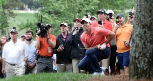 Rory McIlroy  after his shot on the fifth hole during the final round of the  Wells Fargo Championship at Quail Hollow club  in Charlotte, North Carolina. Photograph:   Streeter Lecka/Getty Images