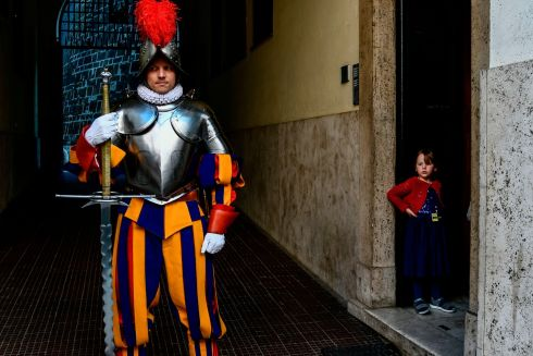 PAPAL PROTECTOR: A child watches a Swiss Guard attending the annual papal guards swearing-in ceremony at the Vatican. The annual ceremony takes place on May 6th, commemorating the 147 guards who died defending Pope Clement VII on that date in 1527. Photograph: Filippo Monteforte/AFP/Getty