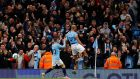 Manchester City's Vincent Kompany celebrates scoring against Leicester. Photograph: Reuters