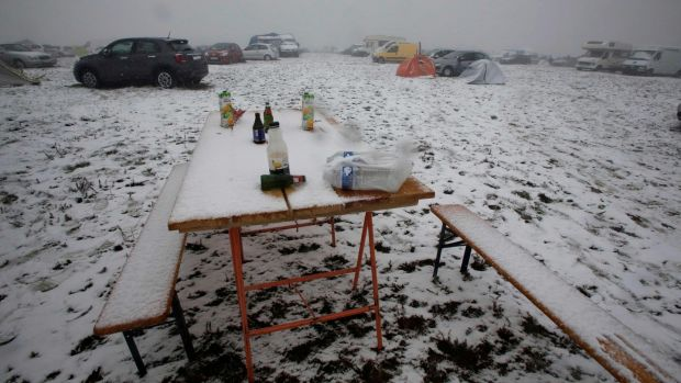 A table covered with snow during the Teknival techno music festival. Photograph: PASCAL LACHENAUD/AFP/Getty Images
