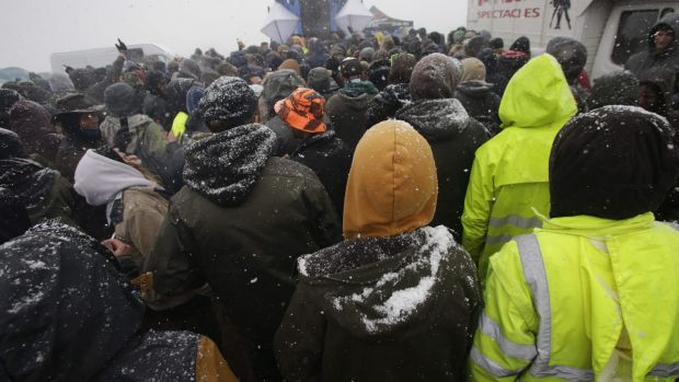 Participants of the Teknival techno music festival as snow falls. Photograph: PASCAL LACHENAUD/AFP/Getty Images