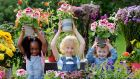 Bloom gardening festival: five-year-old Adrianna Fayiah, seven-year-old Eoghan Fox and four-year-old Florence Marlow Ward help launch this year's event. Photograph: Alan Betson