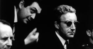 Stanley Kubrick and Peter Sellers on the set of Dr Strangelove or: How I Learned to Stop Worrying and Love the Bomb. Photograph:  The Stanley Kubrick Estate. From Stanley Kubrick, the Exhibition, Berlin, 2005