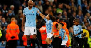 Manchester City's Vincent Kompany with his children  after the victory over Leicester City at the Etihad Stadium. Photograph:  Phil Noble/Reuters