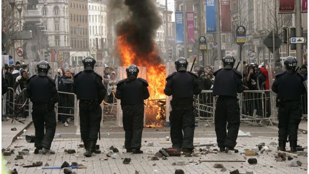 Riot police on O'Connell Street after violence over a planned loyalist parade through the city in February 2006. File photograph: Dara Mac Dónaill
