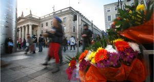 Flowers for sale beside the Spire, on O'Connell Street. File photograph: Dara Mac Dónaill