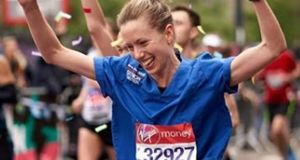 Jessica Anderson running the London Marathon in her nurses's  uniform.  Photograph: Eric Tolentino/PA Wire
