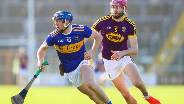 Jason Forde in action against Wexford's Paudie Foley at Wexford Park. Photograph: Tommy Dickson/Inpho