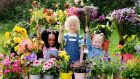 BLOOMING LOVELY: Adrianna Fayiah (5), Tallaght; Eoghan Fox (7), Blessington, and Florence Marlow Ward (4), Walkinstown, at Bord Bia's launch of the 13th annual  Bloom gardens showcase, taking place in the Phoenix Park from Thursday, May 30th to Monday, June 3rd this year. Photograph: Alan Betson