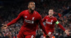 Liverpool's Georginio Wijnaldum celebrates scoring their third goal with Jordan Henderson. Photograph: Phil Noble/Reuters