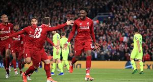 Liverpool's Divock Origi celebrates scoring his second and his side's fourth goal  during the Champions League semi-final second leg agianst Barcelona at Anfield. Photograph: Peter Byrne/PA Wire