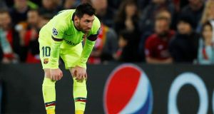 Barcelona's Lionel Messi looks dejected after his side's loss to Liverpool at Anfield in the Champions League semi-finals.  Photo: Phil Noble/Reuters