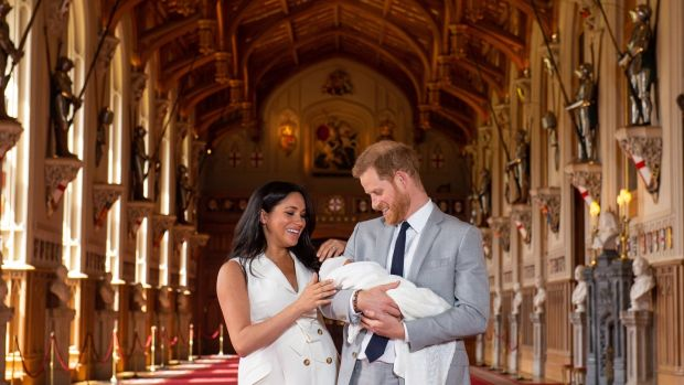 Prince Harry (R) and Meghan Markle, the Duchess of Sussex, pose together with their newborn son. Photograph: Dominic Lipinski /EPA/ PA