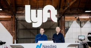 Lyft founders John Zimmer and Logan Green at a party celebrating the ride-hailing company's IPO in March. Photograph: Alex Welsh/The New York Times