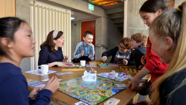 Anna Carey playing board games with children in The Ark, Fionnán O'Baoighill, Sean Cannon and Finn O'Donaill, and (foreground) Amia Zheng, Freya Simpson and Amalia Godley. Photograph: Alan Betson/The Irish Times