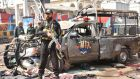 Pakistani security officials at the scene of a bomb attack that targeted a Police vehicle outside the Sufi Muslim Data Gunj Buksh shrine in Lahore, Pakistan. Photograph: EPA