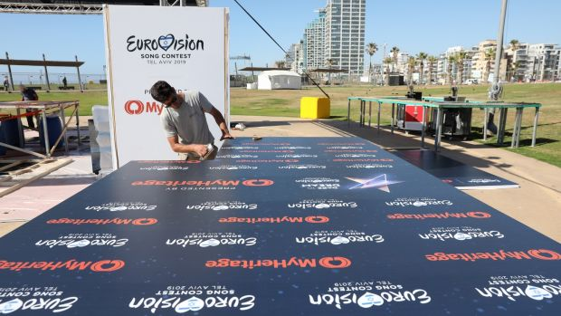 A worker builds a stage as part of the Eurovision Village complex for shows and parties near the beach in Tel Aviv, Israel. Photograph: EPA/Abir Sultan