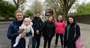Inchicore residents (from left) Lauren Tuite, baby Margot, Gerard Greene, Annie Dibble, Christine Kavanagh and Elizabeth Burns on Grattan Crescent. They object to  trees being cut down to make space for a wider road and bus lane. Photograph: Dara Mac Donaill