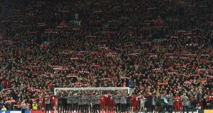 Liverpool celebrate in front of the Kop after winning 4-0 at Anfield. Photo: Getty Images