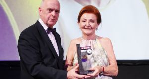 Liam Kavanagh, managing director of The Irish Times, presents the Top 1,000 Distinguished Leader in Business award to Breege O'Donoghue of Primark at The Irish Times Business Awards. Photograph: Kieran Harnett