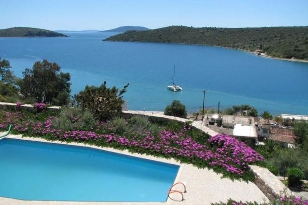 Greece: this three-storey house with pool has sweeping views of the Aegean, 150m away