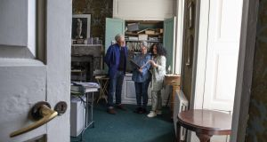 Food historian Regina Sexton (right) looking through some of Myrtle Allen's papers in her former study at Ballymaloe House with her daughter Fern and Rory O'Connell.