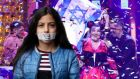 Nothing to sing about?: 10-year-old Mona Abdulmagid (foreground of montage) takes part in the the Ireland Palestine Alliance's boycott-Eurovision campaign. Last year's winner was the Israeli singer Netta Barzilai (background)
