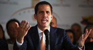Venezuelan opposition leader and self-declared president Juan Guaidó speaks during a press conference at Altamira neighborhood in Caracas. Photograph: Ronaldo Schemidt/AFP/Getty Images