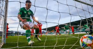 Ireland's Seamas Keogh collects the ball after his team's goal against Belgium. Photograph: Ryan Byrne/Inpho