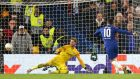 Eden Hazard of Chelsea scores the winning penalty. Photograph: Getty Images