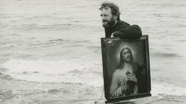 Druid co-founder Mick Lally bringing props for Druid's Playboy from a boat to the Aran Islands, 1982. Photograph: James Hardiman Library.