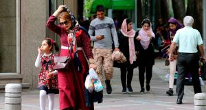 Iranians on  Valiasr Street in northern Tehran earlier this week. Inflation in Iran is at about 40 per cent and the rial is down 60 per cent on the year. Photograph: Atta Kenare/AFP/Getty Images