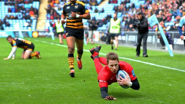 Liam Williams dives to score for Saracens against Wasps. Photograph: Alex Livesey/Getty
